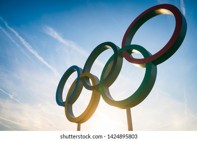 LONDON - APRIL, 2019: The sun sets behind a large set of Olympic Rings.