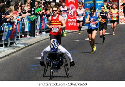 LONDON - APRIL 21: Disabled Participants, wheelchair racing contestants, running in the London Marathon on April, 21, 2013 in London, UK. London Marathon is the World Marathon Majors.