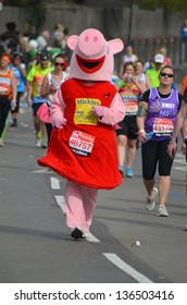 LONDON - APRIL 21:Fun Runners take part in the 2013 London Marathon to raise money for charity on the streets of London April 21st, 2013 in London, England.