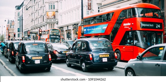 LONDON - APRIL 22, 2018: Panoramic View of Traffic Jam in London with Taxi Cars and Red Busses