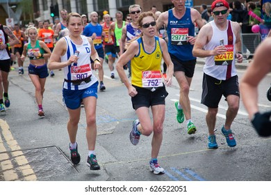 LONDON - APRIL 23, 2017: Unidentified group of people run in the Virgin Money London Marathon on April 23, 2017 in Isle of Dogs.