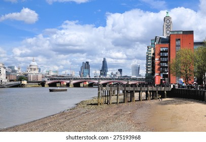 LONDON - APRIL 25, 2015. Low tide on the River Thames by Blackfriars Bridge and the Oxo Tower Wharf housing a community of design boutiques, studios, galleries and restaurants in central London.