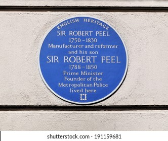 LONDON - APRIL 26. A commemorative wall plaque on April 26, 2014, for Robert Peel and his son Prime Minister and founder of the Metropolitan Police on their house at 16 Grosvenor Street, London, UK.