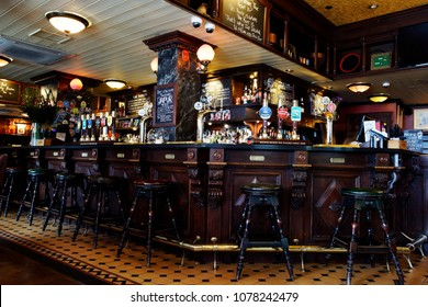 LONDON - April 26: Interior of pub, for drinking and socializing, focal point of the community, on April 26, 2017, London, UK. Pub business, now about 53,500 pubs in UK, has been declining every year.