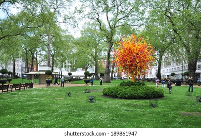 LONDON - APRIL 26. The Sun glass sculpture by USA artist Dale Chihuly stands 18 feet (5.5metres) high with over 1300 hand-blown elements, on display on April 26, 2014 in Berkeley Square, London, UK.