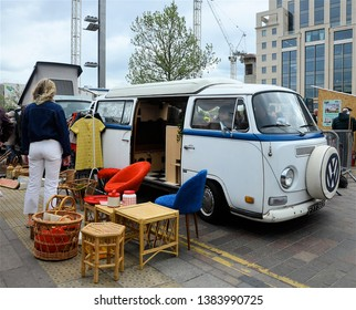 LONDON - APRIL 27, 2019. The Classic Car Boot Sale, where traders bring their used goods to sell from their vintage vehicles, located across Granary Square in the King's Cross area of London, UK.