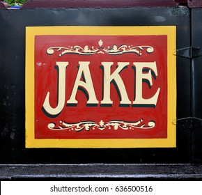 LONDON - APRIL 29. 2017. A traditional drop shadow style hand painted name on a narrow boat mooring at the Grand Union Canal during the annual Canalway Calvalcade at Little Venice, west London.