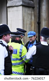 LONDON - APRIL 29 - Police arrest a man for breaking through the security cordon at the Royal Wedding of Prince William and Kate Middleton at Westminster Abbey in London, April 29, 2011