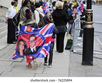 LONDON - APRIL 29 - Unidentified members of the public celebrate the Royal Wedding of Prince William and Kate Middleton on April 29, 2011 at Westminster Abbey in London, England.