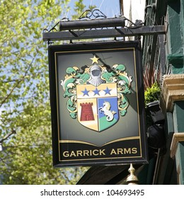 LONDON - APRIL 30: English pub sign, Public house, known as pub, is focal point of community, on April 30, 2012, London, UK. Pub business, now about 53,500 pubs in UK, has been declining every year