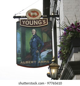 LONDON - APRIL 30: English pub sign, Public house, known as pub, is focal point of the community, on April 30, 2006, London, UK. Pub business, now about 53500 pubs in UK, has been declining every year