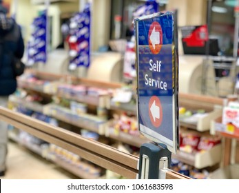 LONDON - APRIL 4, 2018: Self service checkout queue sign at Tesco supermarket in London, UK.