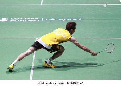 LONDON AUG 14: Lee Chong Wei of Malaysia dives for a shot during the men's singles final against China's Lin Dan at the World Badminton Championships at Wembley Arena in London on August 14, 2011.