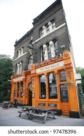 LONDON - AUG 19: Exterior of pub, for drinking and socializing, focal point of the community, on Aug 19, 2010, London, UK. Pub business, now about 53,500 pubs in the UK, has been declining every year