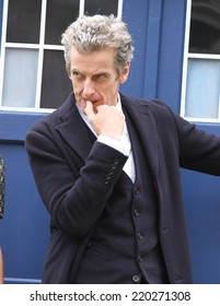 LONDON - AUG 22: Peter Capaldi promoting the new BBC series of 'Dr Who' in Parliament Square on 22, Aug, 2014 in London