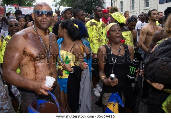 """LONDON - AUG 28: member of """"chocolate nation"""" group parades covered by choco sauce in the Notting Hill Carnival on August 29, 2011 in London, England."""
