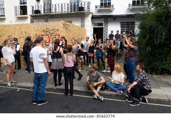 LONDON - AUG 28: youngsters crowd on the street of Notting Hill during the annual Carnival on August 29, 2011 in London, England.