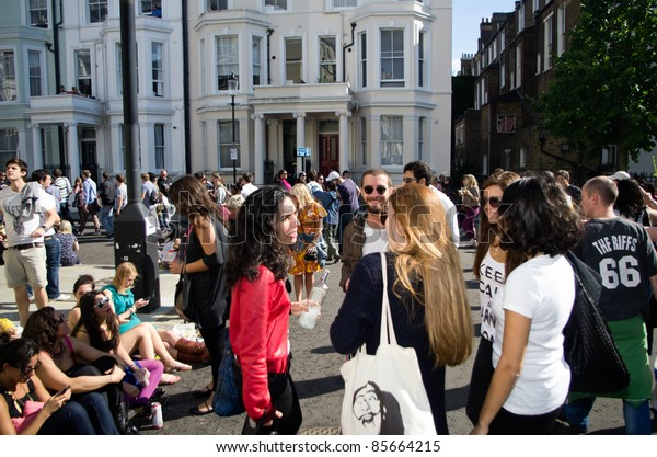 LONDON - AUG 28:youngsters crowd the street of Notting Hill during the annual Carnival on August 29, 2011 in London, England.