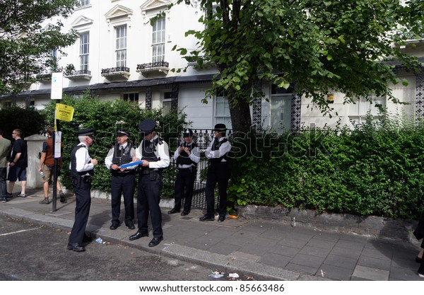 LONDON - AUG 29: police officers patrols the streets of Notting Hill during the traditional annual carnival ion August 29, 2011 in London, England.