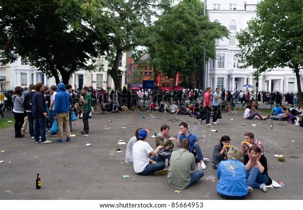 LONDON - AUG 29: youngsters crowd the street of Notting Hill during the annual Carnival on August 29, 2011 in London, England. T