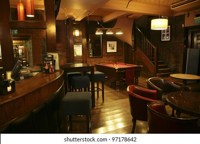 LONDON - AUG 30: Interior of pub, for drinking and socializing, focal point of the community, on Aug 30, 2010, London, UK. Pub business, now about 53,500 pubs in the UK, has been declining every year