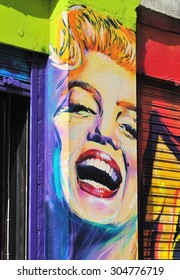 LONDON - AUGUST 1, 2015. Street art of Marilyn Monroe painted between shopfronts at Shoreditch in the Borough of Tower Hamlets, an area renown for its public painting in east London, UK.