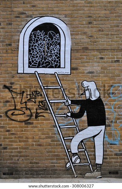 LONDON - AUGUST 1, 2015. Street art at Hanbury Street, Shoreditch in the Borough of Tower Hamlets, an area renown for its public painting, posters and graphics in east London, UK.