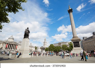 LONDON - AUGUST 10, 2015: Trafalgar square in a sunny day, people and tourists on August 10th, 2015 in London, UK. The square name commemorates the Battle of Trafalgar during the Napoleonic Wars.