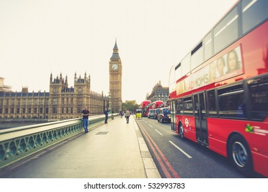 LONDON - August 16, 2016: double decker bus crossing Westminster bridge at sunset with big ben in the background