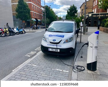 LONDON - AUGUST 17, 2018: A commerical electric vehicle van uses a charging station in London, UK.
