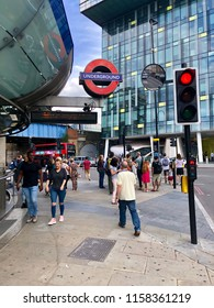 LONDON - AUGUST 17, 2018: Pedestrians outside Southwark Jubilee line underground station in London, UK.