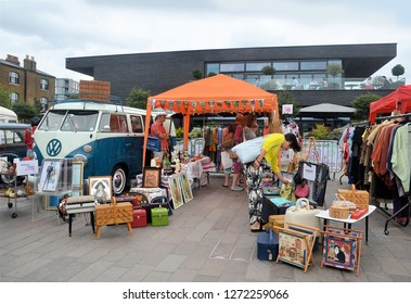 LONDON - AUGUST 18, 2018. The Classic Car Boot Sale, where traders bring their used goods in vintage vehicles, located across Granary Square in the King's Cross area of London, UK.