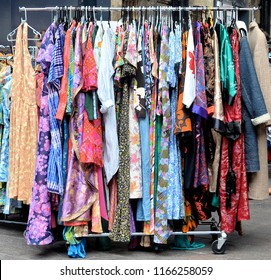 LONDON - AUGUST 18, 2018. A rail of vintage dresses at the Classic Car Boot Sale located across Granary Square in the King's Cross area of London, UK.