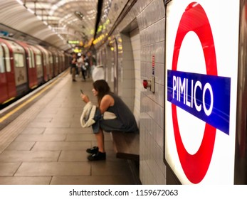 LONDON - AUGUST 19, 2018: Passengers waiting on the platform for the doors to open on an arriving train at Pimlico underground station on the Victoria line in Pimlico, London.