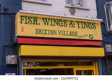 LONDON- AUGUST, 2018: An afro caribbean food stall in Brixton Village, a vibrant indoor street food and boutique shop market in south west London
