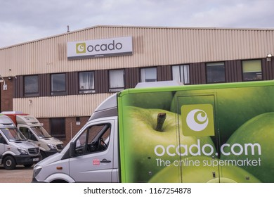 LONDON- AUGUST, 2018: Ocado, a British online supermarket. Exterior of warehouse and delivery trucks in Wimbledon, south west London.