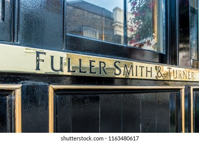 London. August 2018. A view of a Fullers Smith and turners sign in Belgravia in London