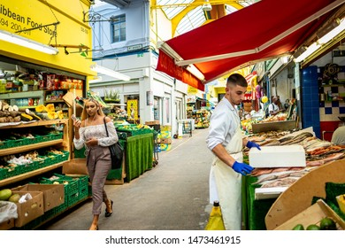 LONDON- AUGUST, 2019: Brixton Village, part of Brixton Market- an indoor hall of food stalls, bars and shops from an ethnically diverse background.
