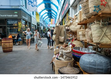 LONDON- AUGUST, 2019: Craft stalls inside Brixton Village, part of Brixton Market- an indoor hall of food stalls, bars and shops from an ethnically diverse background.