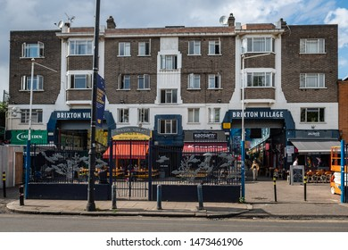 LONDON- AUGUST, 2019: Exterior of Brixton Village, part of Brixton Market- an indoor hall of food stalls, bars and shops from an ethnically diverse background.