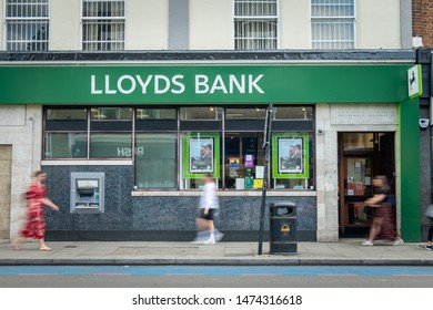 LONDON- AUGUST, 2019: Lloyds Bank branch in south London with motion blurred people, a British High Street bank
