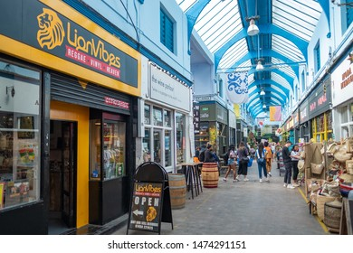 LONDON- AUGUST, 2019: A music shop inside Brixton Village, part of Brixton Market- an indoor hall of food stalls, bars and shops from an ethnically diverse background.