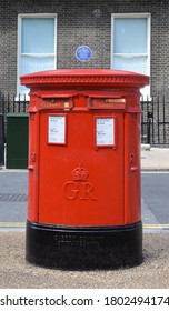 LONDON - AUGUST 22, 2020. A traditional roadside double postal piller box in Bedford Square, central London, UK.