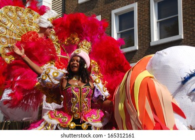 LONDON - AUGUST 26: Performers take part in the second day of Notting Hill Carnival on August 26, 2013 in London, UK. Carnival takes place over two days in every August.