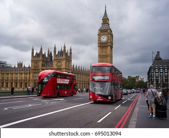 LONDON - AUGUST 28: bus cross the Westminster Bridge, with the Big Ben Tower at the end on the cloudy sky. August 28 2016 in London, England, UK