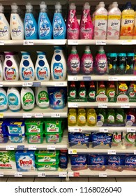 LONDON - AUGUST 30, 2018: Cleaning detergents, fabric softener, washing up liquid and dishwasher tablet products on sale on the shelves and in the aisles of Tesco supermarket in London, UK.