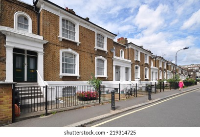 LONDON - AUGUST 4. A terrace of old townhouses, unusually without parked cars on August 4, 2013 at Angel Walk, located in the district of Hammersmith, west London, UK.
