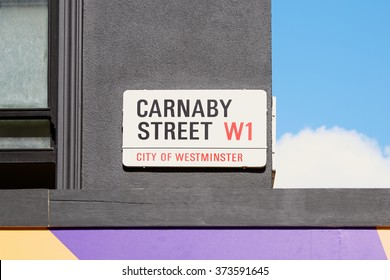LONDON - AUGUST 6: Carnaby street sign, famous shopping street on August 6, 2015 in London. The street is located in Soho district, near Oxford street and Regent street.