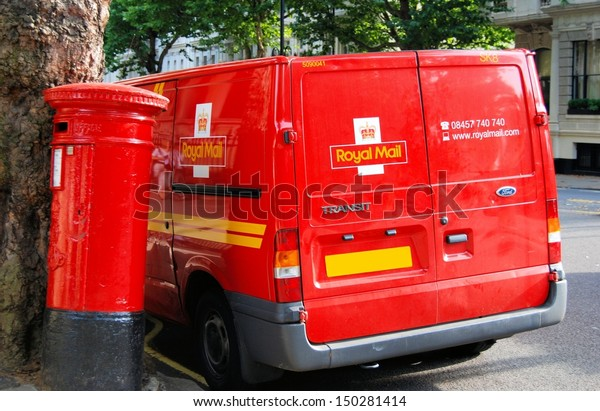 LONDON - AUGUST 6:  Red pillar box and Royal Mail van on August 6, 2008 in London, England.  The British mail system has been around for 100s of years.