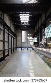 LONDON - AUGUST 8, 2015: Turbine Hall in Tate Modern Art Gallery interior on August 8, 2015 in London, UK. In the 1995 architects Herzog & de Meuron reinvented the current building.